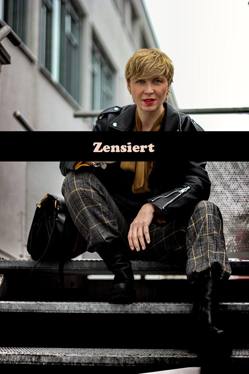 conny doll lifestyle: Stinkefinger, zensiert, weite Hosen und Chunkyboots, Lederjacke, casual Styling